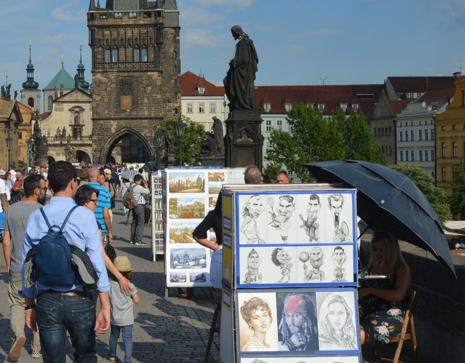 Charles Bridge, always full of tourists ...and artists of different kind too